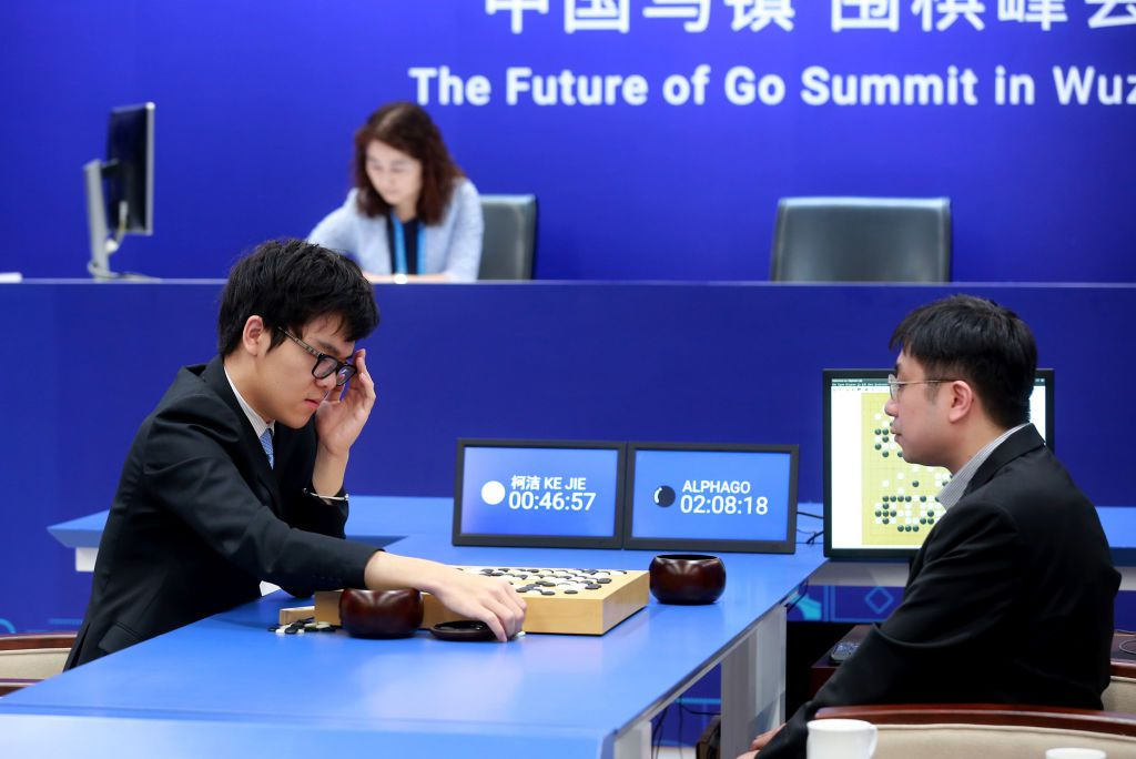 China's 19-year-old Go player Ke Jie (L) prepares to make a move during the second match against Google's artificial intelligence programme AlphaGo in Wuzhen, eastern China's Zhejiang province on May 25, 2017.  Chinese netizens fumed on May 25 over a government ban on live coverage of Google algorithm AlphaGo's battle with the world's top Go player, as the programme clinched their three-match series in the ancient board game. / AFP PHOTO / STR / China OUT        (Photo credit should read STR/AFP/Getty Images)