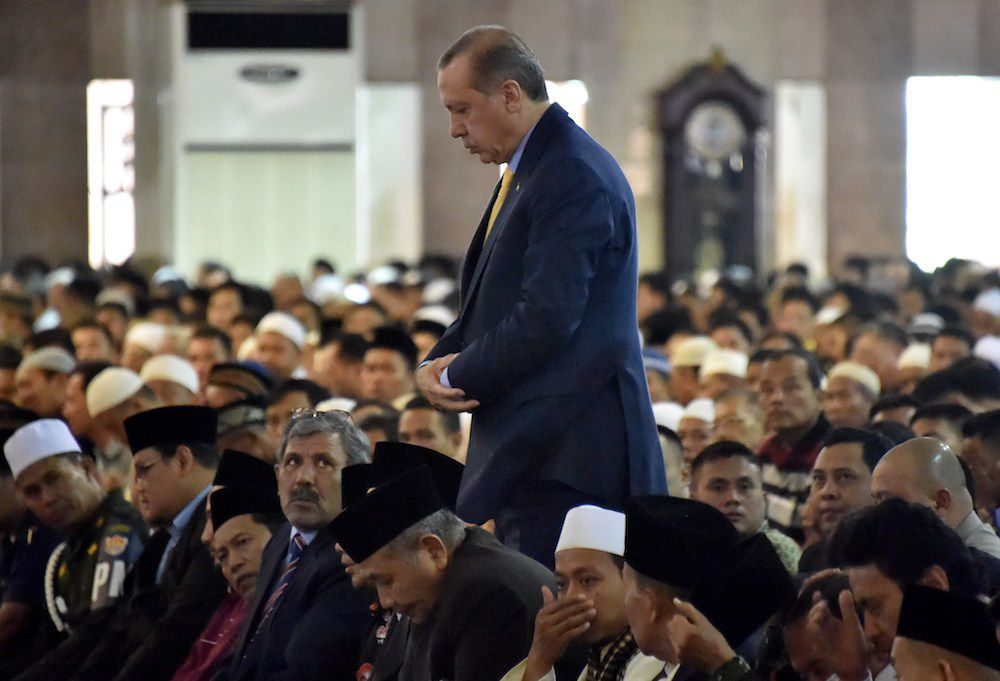 Turkish President Recep Tayyip Erdogan (C) attends a Friday prayer at Istiqlal grand mosque in Jakarta, on July 31, 2015. Erdogan will have several meeting with high ranking officials during his two-day state visit. AFP PHOTO / Bay ISMOYO        (Photo credit should read BAY ISMOYO/AFP/Getty Images)