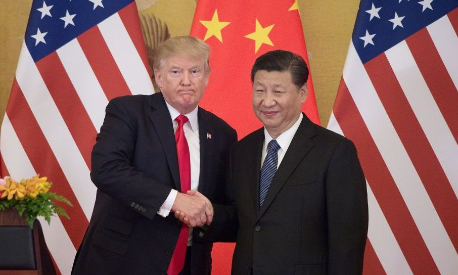 "US President Donald Trump (L) shakes hands with China's President Xi Jinping during a press conference at the Great Hall of the People in Beijing on November 9, 2017.  Donald Trump urged Chinese leader Xi Jinping to work ""hard"" and act fast to help resolve the North Korean nuclear crisis, during their meeting in Beijing Thursday, warning that ""time is quickly running out"". / AFP PHOTO / Nicolas ASFOURI        (Photo credit should read NICOLAS ASFOURI/AFP/Getty Images)"