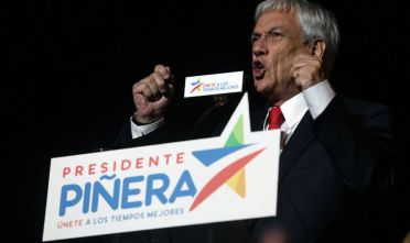 Chilean presidential candidate Sebastian Pinera celebrates his victory with his family and supporters outside a hotel in Santiago after the runoff election on December 17, 2017. Conservative billionaire Sebastian Pinera will return as Chile's president, the election results show. His rival, leftist challenger Alejandro Guillier, a TV presenter turned senator who ran as an independent but was backed by outgoing center-left President Michelle Bachelet, recognized his defeat.  / AFP PHOTO / CLAUDIO REYES /          (Photo credit should read CLAUDIO REYES/AFP/Getty Images)