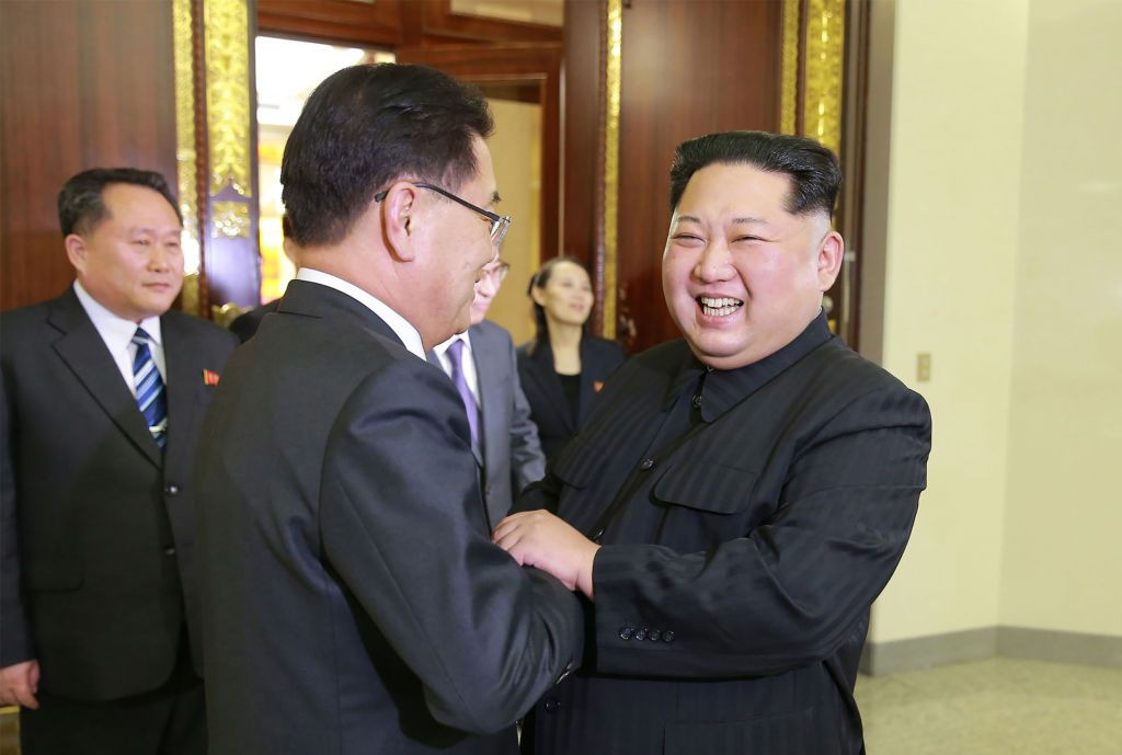 "TOPSHOT - This picture taken on March 5, 2018 and released from North Korea's official Korean Central News Agency (KCNA) on March 6, 2018 shows North Korean leader Kim Jong-Un (R) shaking hands with South Korean chief delegator Chung Eui-yong (C), who travelled as envoys of the South's President Moon Jae-in, during their meeting in Pyongyang.   North Korean leader Kim Jong Un discussed ways to ease tensions on the peninsula with visiting South Korean envoys, the state KCNA news agency reported on March 6. / AFP PHOTO / KCNA VIA KNS / STR / / AFP PHOTO / KCNA VIA KNS / STR / SOUTH KOREA OUT / REPUBLIC OF KOREA OUT   ---EDITORS NOTE--- RESTRICTED TO EDITORIAL USE - MANDATORY CREDIT ""AFP PHOTO/KCNA VIA KNS"" - NO MARKETING NO ADVERTISING CAMPAIGNS - DISTRIBUTED AS A SERVICE TO CLIENTS        (Photo credit should read STR/AFP/Getty Images)"