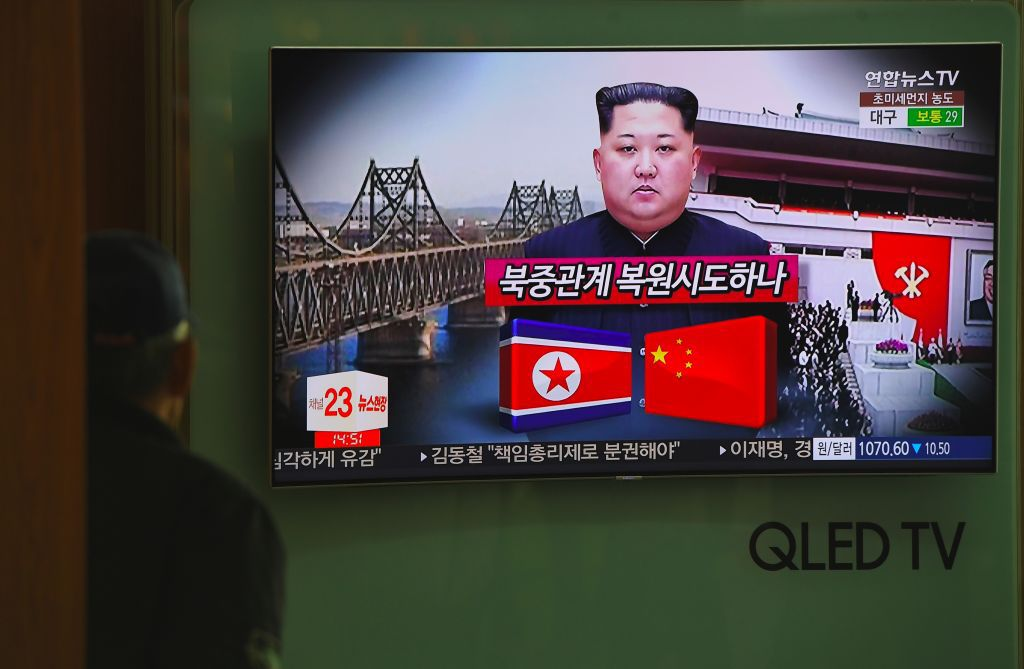 A man watches a television news about a suspected visit to China by North Korean leader Kim Jong Un, at a railway station in Seoul on March 27, 2018. Japanese media reported on March 26 that a train possibly carrying a high-level official from North Korea has arrived in Beijing, sparking speculation that the country's leader, Kim Jong Un, may have been aboard. / AFP PHOTO / Jung Yeon-je        (Photo credit should read JUNG YEON-JE/AFP/Getty Images)