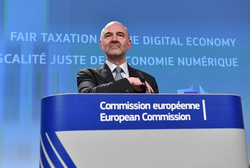"""European Commssioner for Economic and Financial Affairs, Taxation and Customs Pierre Moscovici addresses a press conference at the European Union in Brussels on March 21, 2018. The EU unveiled proposals for a digital tax that targets US tech giants today, bringing yet more problems to Facebook after revelations over misused data of 50 million users shocked the world. """"Our pre-Internet rules do not allow our member states to tax digital companies operating in Europe when they have little or no physical presence here,"""" EU Economics Affairs Commissioner Pierre Moscovici said as he explained the proposals.  / AFP PHOTO / EMMANUEL DUNAND        (Photo credit should read EMMANUEL DUNAND/AFP/Getty Images)"""
