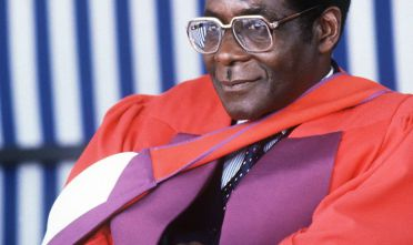 Zimbabwe's Prime Minister Robert Mugabe looks on after being awarded Doctor Honoris Causa at the University of Harare. Mugabe, Zimbabwean first Premier (in 1980) and President (in 1987), was born in Kutama in 1924 (formerly Southern Rhodesia). Largely self-educated, he became a teacher. After a short periods in the National Democratic Party and Zimbabwe African People's Union (ZAPU) he co-found, in 1963, the Zimbabwe African National Union (ZANU). After a 10-year detention in Rhodesia (1964-74), he spent five years in Mozambique gathering support in preparation for independence in 1980. / AFP PHOTO / ALEXANDER JOE        (Photo credit should read ALEXANDER JOE/AFP/Getty Images)