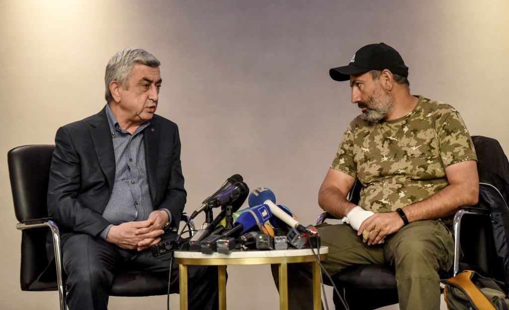 "Armenian Prime Minister Serzh Sarkisian (L) meets with anti-government protest leader Nikol Pashinyan (R) at the start of a televised meeting that he left shortly after it began in an hotel in Yerevan on April 22, 2018, denouncing the opposition's ""blackmail"" after 10 days of mass demonstrations against an alleged power grab by Sarkisian. - Opposition supporters have criticised the 63-year-old leader over poverty, corruption and the influence of powerful oligarchs. Under a new parliamentary system of government, lawmakers elected him as prime minister last week. Constitutional amendments approved in 2015 have transferred power from the presidency to the premier. (Photo by Vano SHLAMOV / AFP) (Photo credit should read VANO SHLAMOV/AFP/Getty Images)"