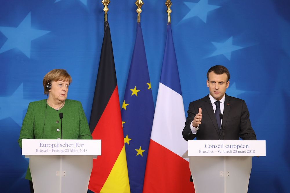 Merkel e Macron al summit europeo del 23 marzo 2018 (Foto: LUDOVIC MARIN/AFP/Getty Images).