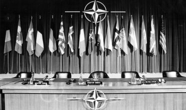 12th December 1984:  A conference table ready for a press conference for Lord Carrington, the Secretary General of NATO in Brussels.  (Photo by Hulton Archive/Getty Images)