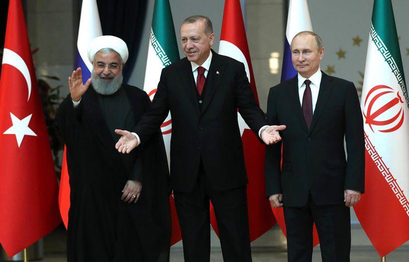 Rohani, Erdoğan e Putin al vertice di Ankara sulla Siria, 4 aprile 2018. Foto di Tolga Bozoglu/Afp/Getty Images