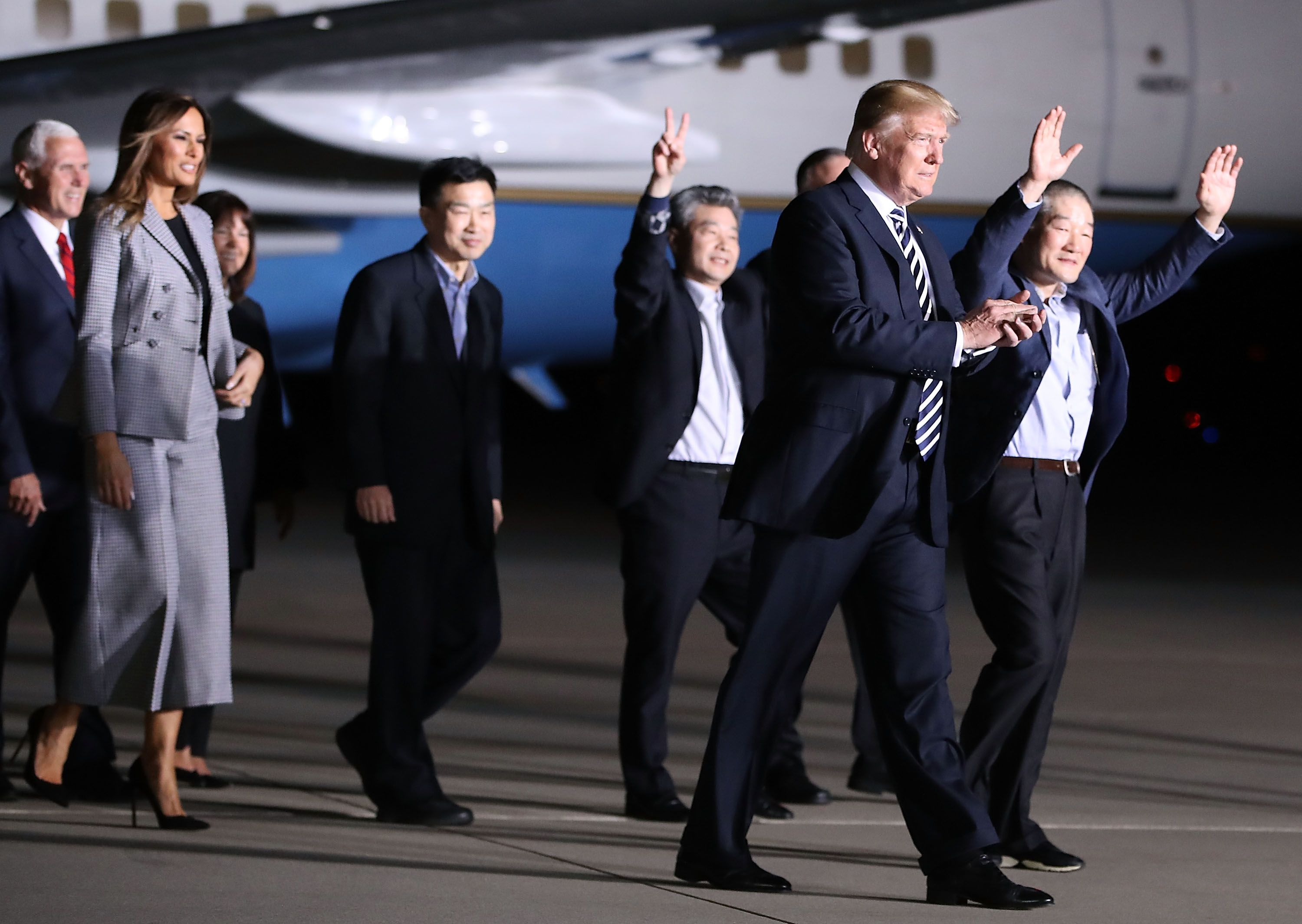 JOINT BASE ANDREWS, MD - MAY 10:  U.S. President Donald Trump walks with the three Americans just released from North Korea, Kim Dong Chul, Kim Hak-song and Tony Kim at Joint Base Andrews on May 9, 2018  in Maryland.  Secretary of State Mike Pompeo traveled to North Korea and returned with the three men who have been detained in North Korea.  (Photo by Mark Wilson/Getty Images)