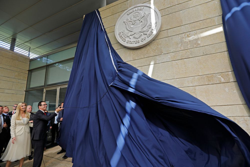 TOPSHOT - US Treasury Secretary Steve Mnuchin and US President's daughter Ivanka Trump unveil an inauguration plaque during the opening of the US embassy in Jerusalem on May 14, 2018. - The United States moved its embassy in Israel to Jerusalem after months of global outcry, Palestinian anger and exuberant praise from Israelis over President Donald Trump's decision tossing aside decades of precedent. (Photo by Menahem KAHANA / AFP)        (Photo credit should read MENAHEM KAHANA/AFP/Getty Images)
