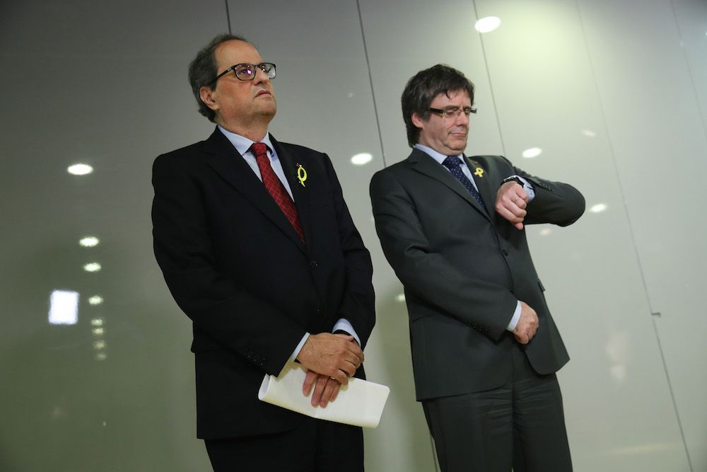BERLIN, GERMANY - MAY 15:  Newly-elected Catalan leader Quim Torra (L) and former Catalan separitist leader Carles Puigdemont arrive to speak to the media on May 15, 2018 in Berlin, Germany. Torra, who was sworn in by the Catalan parliament yesterday, has vowed to continue Catalonia's drive for independence from Spain.  (Photo by Sean Gallup/Getty Images)