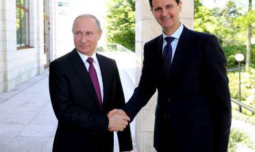 Vladimir Putin e Bashar al-Assad a Sochi il 17 maggio 2018. Foto di: MIKHAIL KLIMENTYEV/AFP/Getty Images