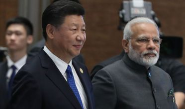 (L to R) Chinese President Xi Jinping and Indian Prime Minister Narendra Modi attend the Dialogue of Emerging Market and Developing Countries on the sidelines of the 2017 BRICS Summit in Xiamen, southeastern China's Fujian Province on September 5, 2017. Xi opened the annual summit of BRICS leaders that already has been upstaged by North Korea's latest nuclear weapons provocation. / AFP PHOTO / POOL / WU HONG        (Photo credit should read WU HONG/AFP/Getty Images)