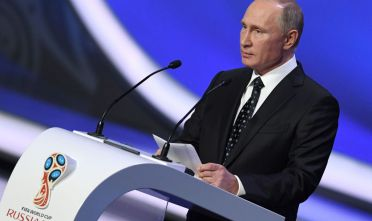 Russian President Vladimir Putin delivers a speech ahead of the 2018 FIFA World Cup football tournament final draw at the State Kremlin Palace in Moscow on December 1, 2017. The 2018 FIFA World Cup will be held between June 14 and July 15, 2018 in 11 Russian cities. / AFP PHOTO / Kirill KUDRYAVTSEV        (Photo credit should read KIRILL KUDRYAVTSEV/AFP/Getty Images)