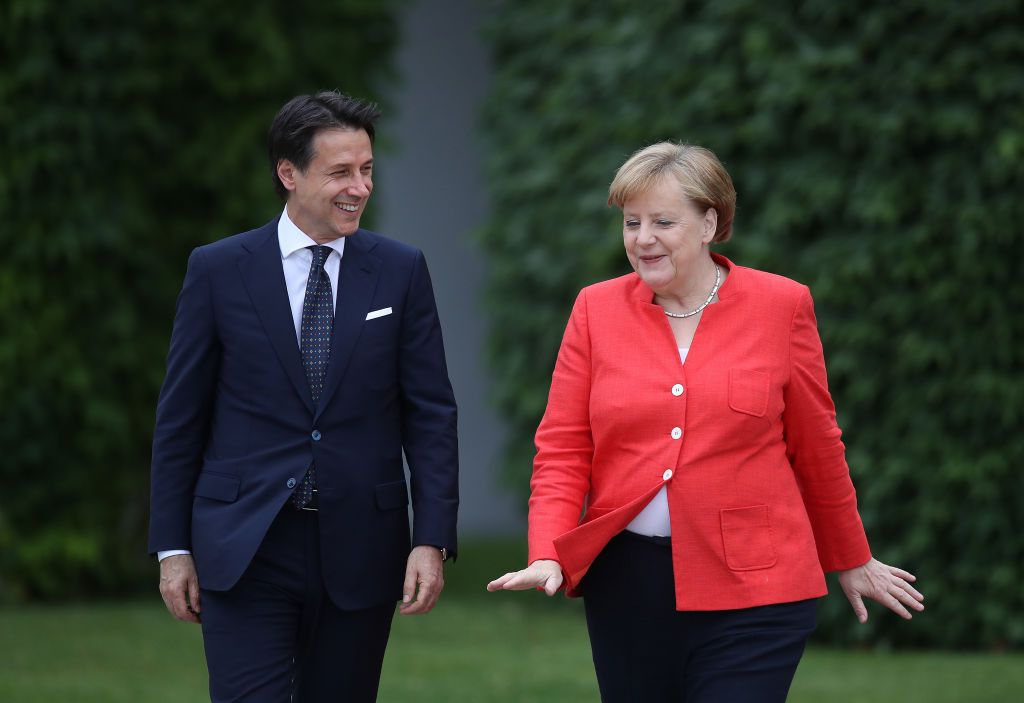 BERLIN, GERMANY - JUNE 18:  German Chancellor Angela Merkel and Italian Prime Minister Guiseppe Conte chat upon Conte's arrival at the Chancellery on June 18, 2018 in Berlin, Germany. This is Conte's first visit to Germany since he recently took office.  (Photo by Sean Gallup/Getty Images)