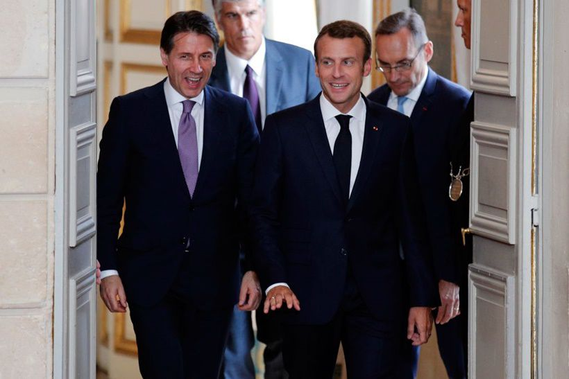 """French President Emmanuel Macron (R) and Italian Prime Minister Giuseppe Conte arrive for a joint press conference following their meeting at the Elysee presidential Palace in Paris on June 15, 2018, after a bitter diplomatic spat between France and Italy over the new Italian government's refusal to give the Aquarius rescue ship, carrying 629 migrants, permission to dock. - Conte called today for the European Union to set up centres to process migrants' asylum claims in their home countries, a proposal backed by French President Emmanuel Macron. The French president urged greater solidarity with Rome over the migrant crisis, calling for """"profound reforms"""" of EU asylum rules known as the Dublin regulation. (Photo by Francois Mori / POOL / AFP)        (Photo credit should read FRANCOIS MORI/AFP/Getty Images)"""
