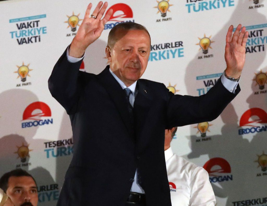 Turkish President Tayyip Erdogan greets supporters at the AKP headquarters in Ankara, Turkey on June 25, 2018. - Turkish President Recep Tayyip Erdogan has won tightly-contested presidential polls, the election authority said on June 25, extending his 15-year grip on power as the opposition complained bitterly about the conduct of the vote count. (Photo by Adem ALTAN / AFP)        (Photo credit should read ADEM ALTAN/AFP/Getty Images)