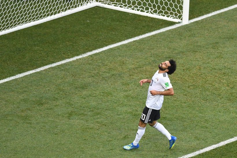 TOPSHOT - Egypt's forward Mohamed Salah reacts after missing a shot during the Russia 2018 World Cup Group A football match between Saudi Arabia and Egypt at the Volgograd Arena in Volgograd on June 25, 2018. (Photo by Mark RALSTON / AFP) / RESTRICTED TO EDITORIAL USE - NO MOBILE PUSH ALERTS/DOWNLOADS        (Photo credit should read MARK RALSTON/AFP/Getty Images)