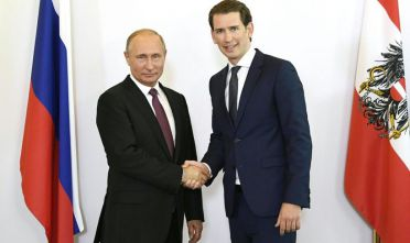 Russian President Vladimir Putin (L) and Austrian Chancellor Sebastian Kurz shak hands in Vienna, Austria, June 5, 2018. - President Putin is on a one-day state visit to Austria. (Photo by ROBERT JAEGER / APA / AFP) / Austria OUT        (Photo credit should read ROBERT JAEGER/AFP/Getty Images)