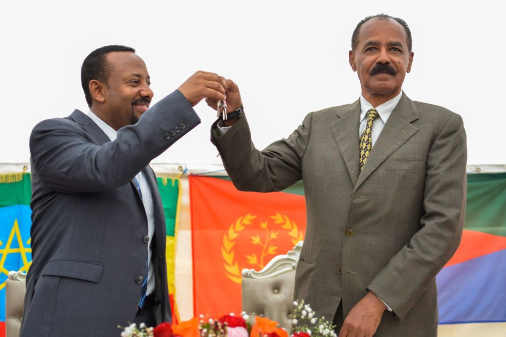 Ethiopian Prime Minister Abiy Ahmed (L) and President Isaias Afwerki of Eritrea (R) celebrate the opening of the Embassy of Eritrea in Ethiopia reopened following the official visit after twenty years, in Addis Ababa on July 13, 2018. (Photo by MICHAEL TEWELDE / AFP)        (Photo credit should read MICHAEL TEWELDE/AFP/Getty Images)