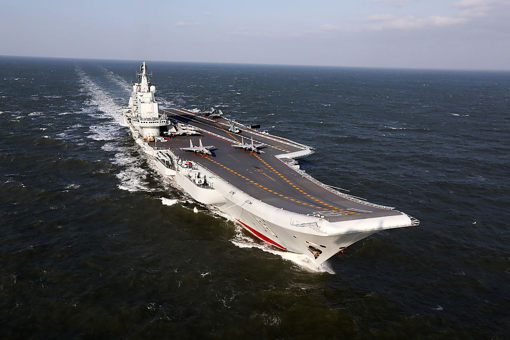 This photo taken on December 24, 2016 shows the Liaoning, China's only aircraft carrier, sailing during military drills in the Pacific.  Taiwan's defence minister warned on December 27 that enemy threats were growing daily after China's aircraft carrier and a flotilla of other warships passed south of the island in an exercise as tensions rise. / AFP / STR / China OUT        (Photo credit should read STR/AFP/Getty Images)