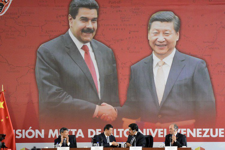 Venezuelan President Nicolas Maduro (2-R) shakes hands with China's President Xi Jinping (2-L) during a signing-of-agreements ceremony, in Caracas on July 21, 2014. On the last day of his two-day visit to Venezuela, Xi signed agreements that will tie his energy-hungry country to the South American oil-rich state. AFP PHOTO/LEO RAMIREZ        (Photo credit should read LEO RAMIREZ/AFP/Getty Images)