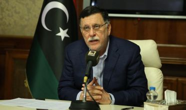 Libya's unity government Prime Minister Fayez al-Sarraj speaks about the latest situations in the capital Tripoli on August 30, 2018. - At least 27 people have been killed and nearly 100 wounded in several days of fighting between rival militias near the Libyan capital, the health ministry said today. (Photo by STR / AFP)        (Photo credit should read STR/AFP/Getty Images)