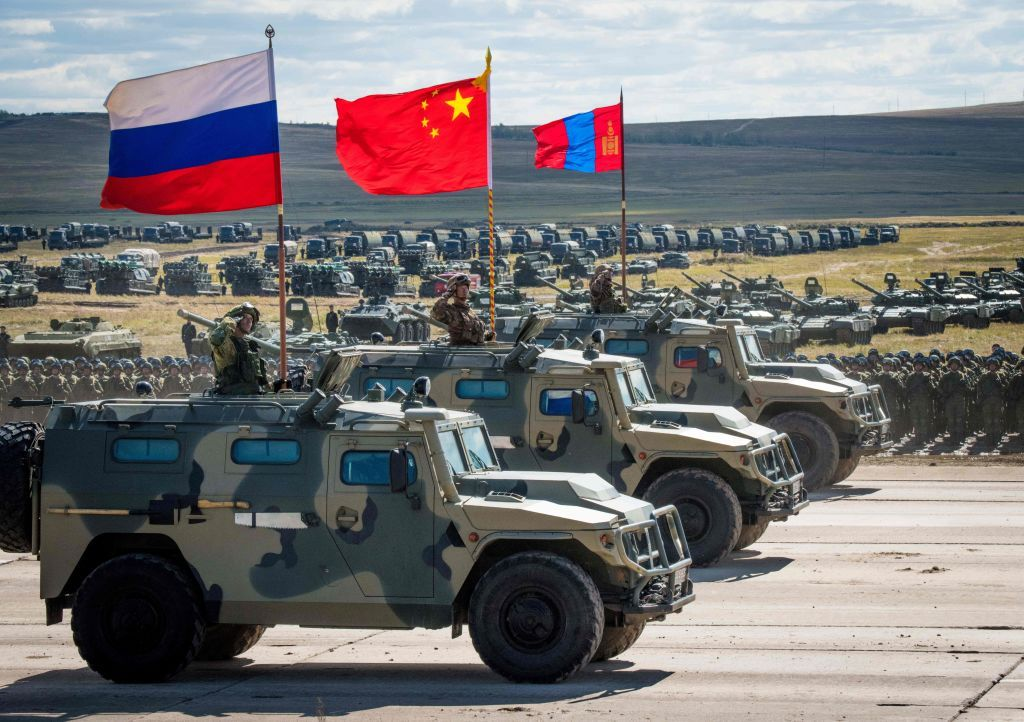 Russian, Chinese and Mongolian troops and military equipment parade at the end of the day of the Vostok-2018 (East-2018) military drills at Tsugol training ground not far from the Chinese and Mongolian border in Siberia, on September 13, 2018. (Photo by MLADEN ANTONOV / AFP)        (Photo credit should read MLADEN ANTONOV/AFP/Getty Images)