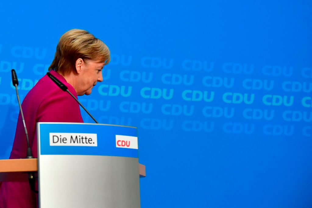German Chancellor and leader of the Christian Democratic Union (CDU) Angela Merkel leaves the stage after a press conference at the CDU headquarters on October 29, 2018 in Berlin, one day after the regional state elections in Hesse. - German Chancellor Angela Merkel announced she will not stand again as leader of her centre-right CDU, which she has chaired the CDU for 18 years, and step down as German chancellor when her mandate ends in 2021, making way for a successor following a series of regional vote defeats. (Photo by Tobias SCHWARZ / AFP)        (Photo credit should read TOBIAS SCHWARZ/AFP/Getty Images)