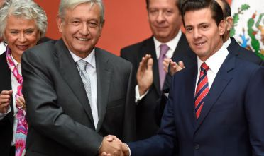Mexican President-elect Andres Manuel Lopez Obrador (L) shakes hands with current President Enrique Pena Nieto at the National Palace in Mexico City during a ceremony where Lopez Obrador presented his new cabinet, on August 20, 2018. (Photo by Alfredo ESTRELLA / AFP)        (Photo credit should read ALFREDO ESTRELLA/AFP/Getty Images)