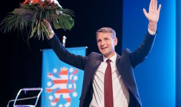 Bjoern Hoecke, politician of Germany's anti-immigration AfD party (Alternative for Germany), holds a bouquet of flowers and waves to supporters after he was elected the party's top candidate for 2019 regional elections in Thuringia during a regional AfD party congress in Arnstadt near Erfurt, central Germany, on October 13, 2018. (Photo by arifoto UG / dpa / AFP) / Germany OUT        (Photo credit should read ARIFOTO UG/AFP/Getty Images)