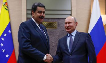 Russian President Vladimir Putin (R) shakes hands with his Venezuelan counterpart Nicolas Maduro during a meeting at the Novo-Ogaryovo state residence outside Moscow on December 5, 2018. (Photo by MAXIM SHEMETOV / POOL / AFP)        (Photo credit should read MAXIM SHEMETOV/AFP/Getty Images)
