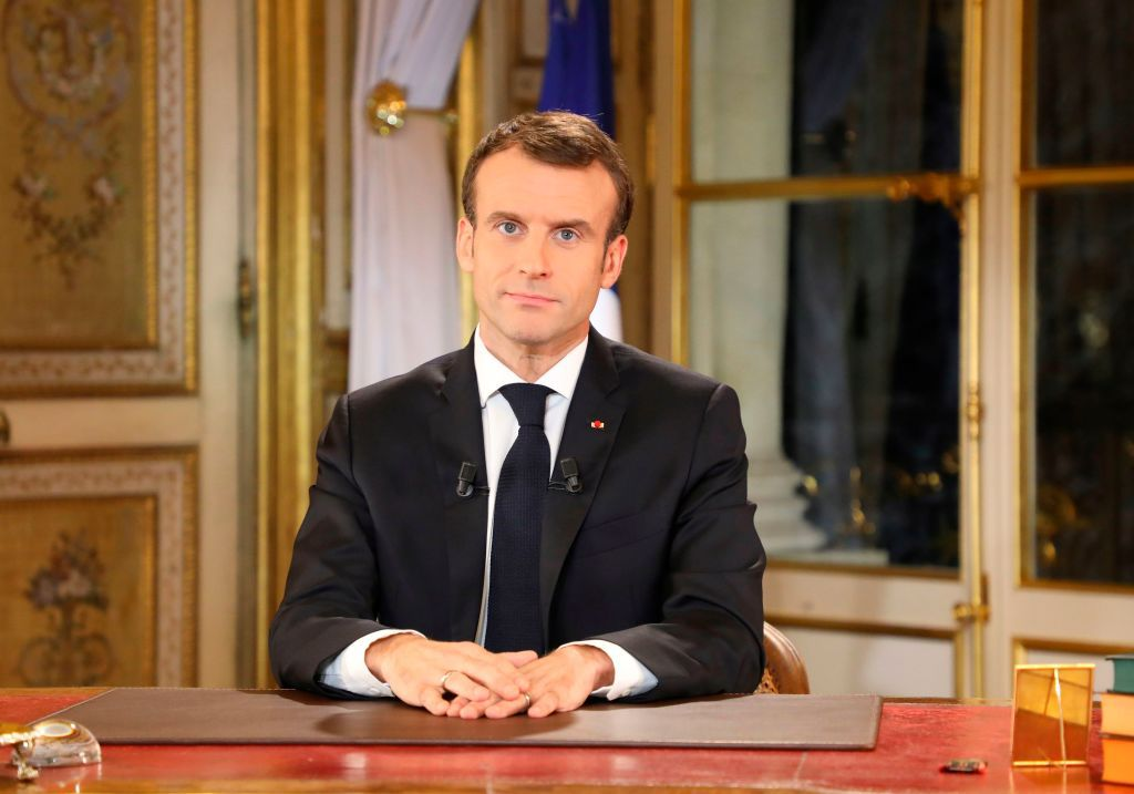 TOPSHOT - French President Emmanuel Macron speaks during a special address to the nation, his first public comments after four weeks of nationwide 'yellow vest' (gilet jaune) protests, on December 10, 2018, at the Elysee Palace, in Paris. (Photo by LUDOVIC MARIN / POOL / AFP)        (Photo credit should read LUDOVIC MARIN/AFP/Getty Images)