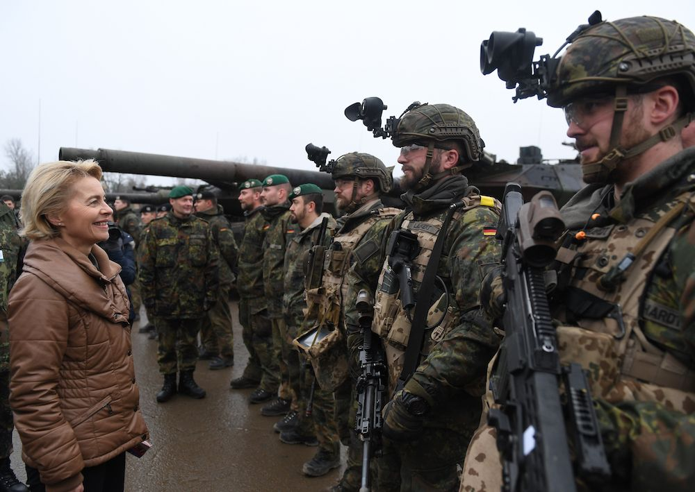 MUNSTER, GERMANY - DECEMBER 06: German Defense Minister Ursula von der Leyen chats with soldiers of the Bundeswehr during a visit to a Bundeswehr infantry training facility on December 6, 2018 in Munster, Germany. Germany is increasing its annual defense budget following reports over recent years of a large portion of its military planes, ships, tanks and other weaponry as grounded due to lack of spare parts. (Photo by David Hecker/Getty Images)