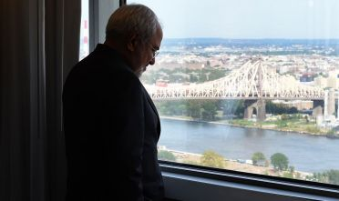 Iran Foreign Minister Mohammad Javad Zarif looks out the window from a hotel room towards the East River while he waits for French Foreign Affairs Minister Jean-Marc Ayrault to arrive for a bilateral meeting in New York on the sidelines of the 71st session of the UN General Assembly in New York September 21, 2016. / AFP / TIMOTHY A. CLARY        (Photo credit should read TIMOTHY A. CLARY/AFP/Getty Images)