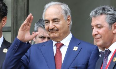 Libya Chief of Staff, Marshall Khalifa Haftar, whose rival Libyan National Army dominates the country's east, gestures as he  stands on the steps of the Elysee Palace following the International conference on Libya on May 29, 2018, in Paris. - Four Libyan leaders on May 29, 2018 committed to holding elections in the fractured country on December 10 in a joint statement issued at a peace conference in Paris. (Photo by ludovic MARIN / AFP)        (Photo credit should read LUDOVIC MARIN/AFP/Getty Images)