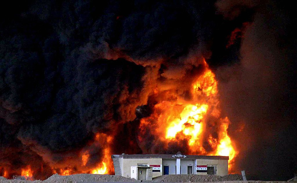TARI AL-BAGHL, Iraq:  Black smoke engulfs a small Iraqi army post at the site where an Iraqi pipeline was set ablaze near the village of Tari al-Baghl, west of the northern city of Kirkuk 20 October 2005.Saboteurs attacked northern Iraq oil pipelines at dawn setting one ablaze and halting shipments towards a Turkish terminal at the Mediterranean port of Ceyhan.  Pumping towards Turkey was stopped to help fight the blaze, but it was not known if production would be durably affected, the industry source said.      AFP PHOTO/MARWAN IBRAHIM  (Photo credit should read MARWAN IBRAHIM/AFP/Getty Images)