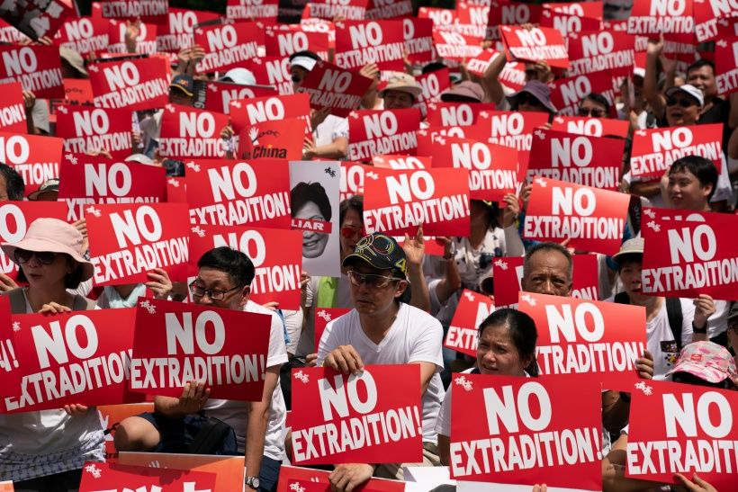 HONG KONG, HONG KONG - JUNE 09:  Protesters hold placards and shout slogans during a rally against the extradition law proposal on June 9, 2019 in Hong Kong China. Hundreds of thousands of protesters marched in Hong Kong in Sunday against a controversial extradition bill that would allow suspected criminals to be sent to mainland China for trial.(Photo by Anthony Kwan/Getty Images)