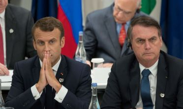 France's President Emmanuel Macron (L) and Brazil's President Jair Bolsonaro attend a meeting on the digital economy at the G20 Summit in Osaka on June 28, 2019. (Photo by Jacques Witt / POOL / AFP)        (Photo credit should read JACQUES WITT/AFP/Getty Images)
