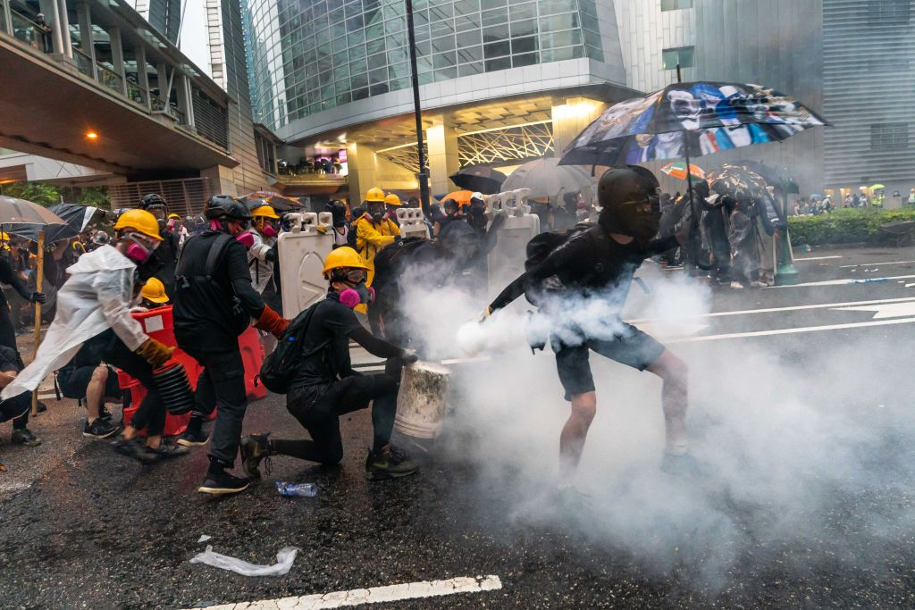 """HONG KONG - AUGUST 25: Protesters clash with police after a rally in Tsuen Wan on August 25, 2019 in Hong Kong, China. Pro-democracy protesters have continued rallies on the streets of Hong Kong against a controversial extradition bill since 9 June as the city plunged into crisis after waves of demonstrations and several violent clashes. Hong Kong's Chief Executive Carrie Lam apologized for introducing the bill and declared it """"dead"""", however protesters have continued to draw large crowds with demands for Lam's resignation and completely withdraw the bill. (Photo by Billy H.C. Kwok/Getty Images)"""