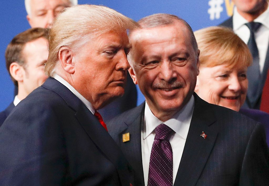 TOPSHOT - US President Donald Trump (L) and Turkey's President Recep Tayyip Erdogan (R) leave the stage after the family photo to head to the plenary session at the NATO summit at the Grove hotel in Watford, northeast of London on December 4, 2019. (Photo by PETER NICHOLLS / POOL / AFP) (Photo by PETER NICHOLLS/POOL/AFP via Getty Images)
