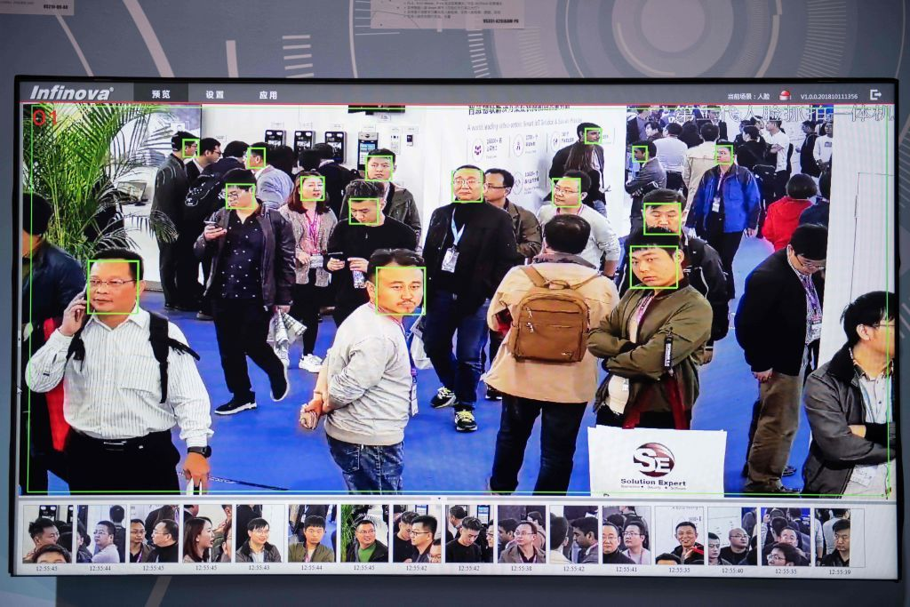 A screen shows visitors being filmed by AI (Artificial Inteligence) security cameras with facial recognition technology at the 14th China International Exhibition on Public Safety and Security at the China International Exhibition Center in Beijing on October 24, 2018. (Photo by NICOLAS ASFOURI / AFP)        (Photo credit should read NICOLAS ASFOURI/AFP via Getty Images)