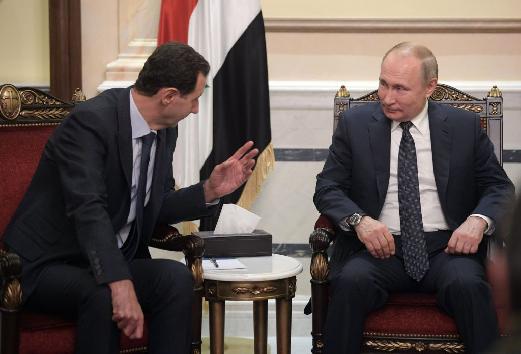 TOPSHOT - Russian President Vladimir Putin and Syrian President Bashar al-Assad hold a meeting in Damascus on January 7, 2020. - Putin met his Syrian counterpart Bashar al-Assad during an unprecedented visit to Damascus as the prospect of war between Iran and the United States loomed over the region. (Photo by Alexey DRUZHININ / SPUTNIK / AFP) (Photo by ALEXEY DRUZHININ/SPUTNIK/AFP via Getty Images)