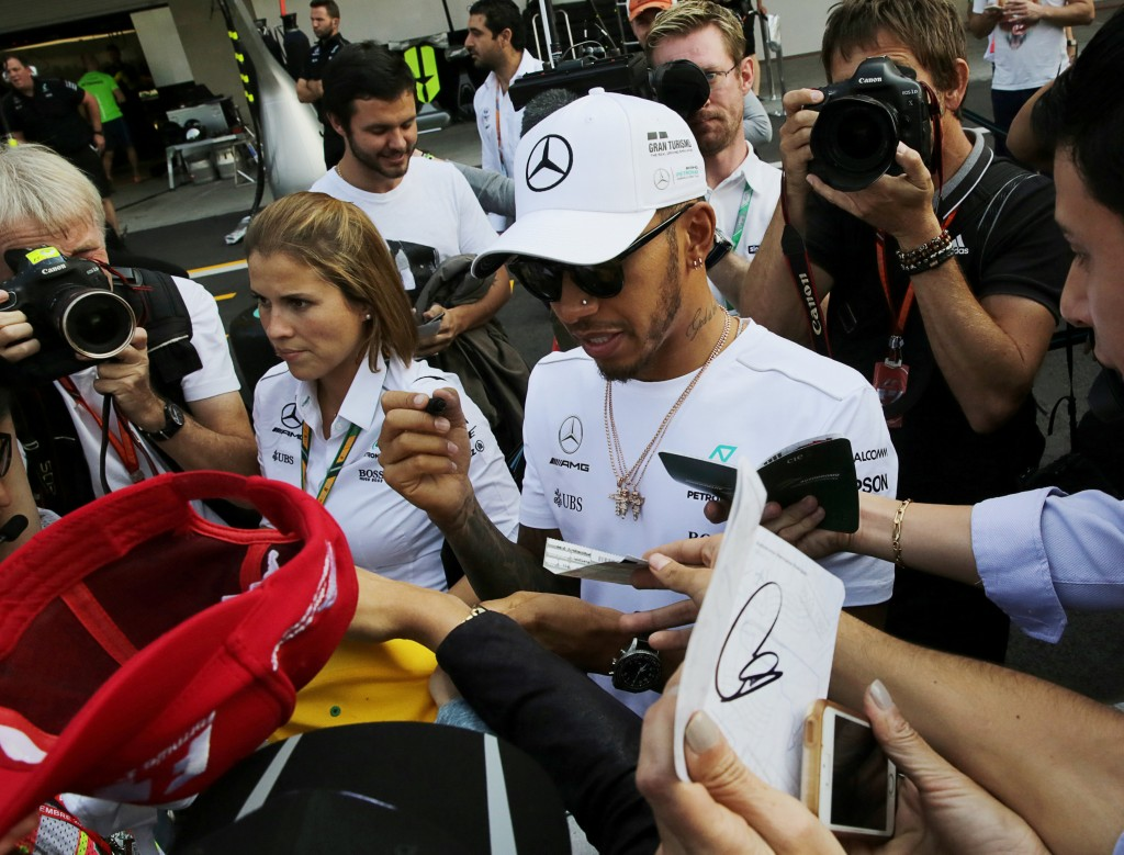 Mercedes' Lewis Hamilton of Britain autographs a cap for a fan ahead of the Mexican F1 Grand Prix on October 29, at Autodromo Hermanos Rodriguez in Mexico City