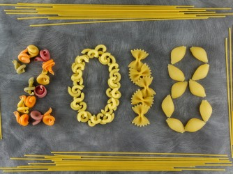 Background of food ingredients.New Year theme. Different kinds of pasta. Macaroni from whole wheat, spaghetti, noodles, tselentani, chiferi, fusilli, shells, rotelle