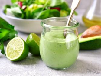 Homemade avocado yogurt dressing in a vintage glass jar