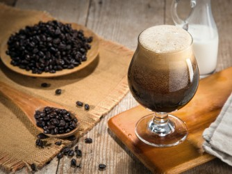 Nitro coffee nitrous infused delicious serving in tulip glass wooden