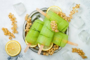 Detox cucumber lemon juice popsicles with white currant. Top view, overhead.
