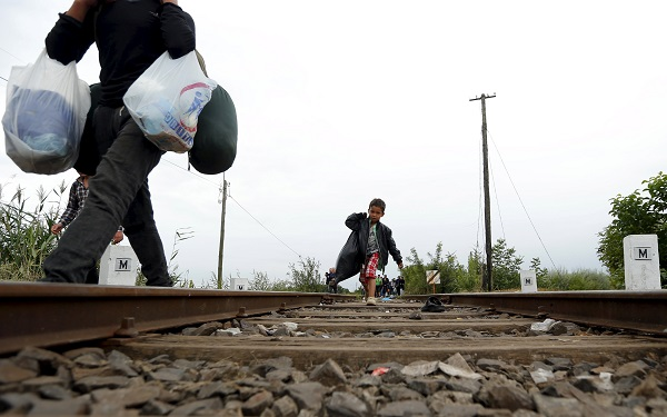 Syrian migrant child walks on a railway track after crossing the Hungarian-Serbian border into Hungary, near Roszke