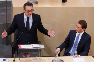 Vice Chancellor Strache of the FPOe delivers a speech next to Chancellor Kurz of the OeVP during a session of the parliament in Vienna